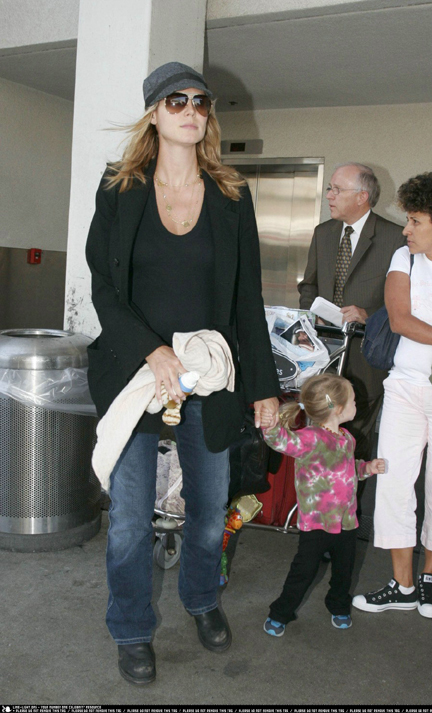 Heidi and family arriving in LAX airport on 9/16/06, she is pictured with ...